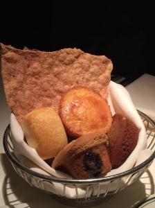 Delicious bread assortment: blueberry muffin, cinnamon bread, gingerbread, etc.