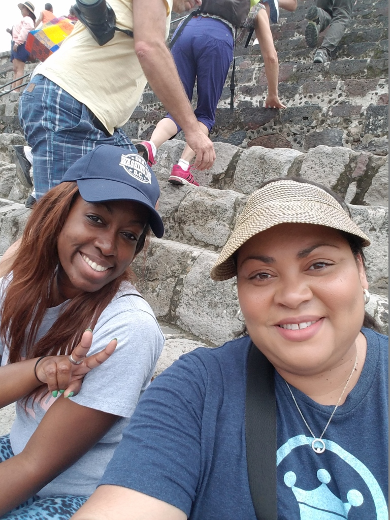 All smiles after climbing Pyramid of the Moon