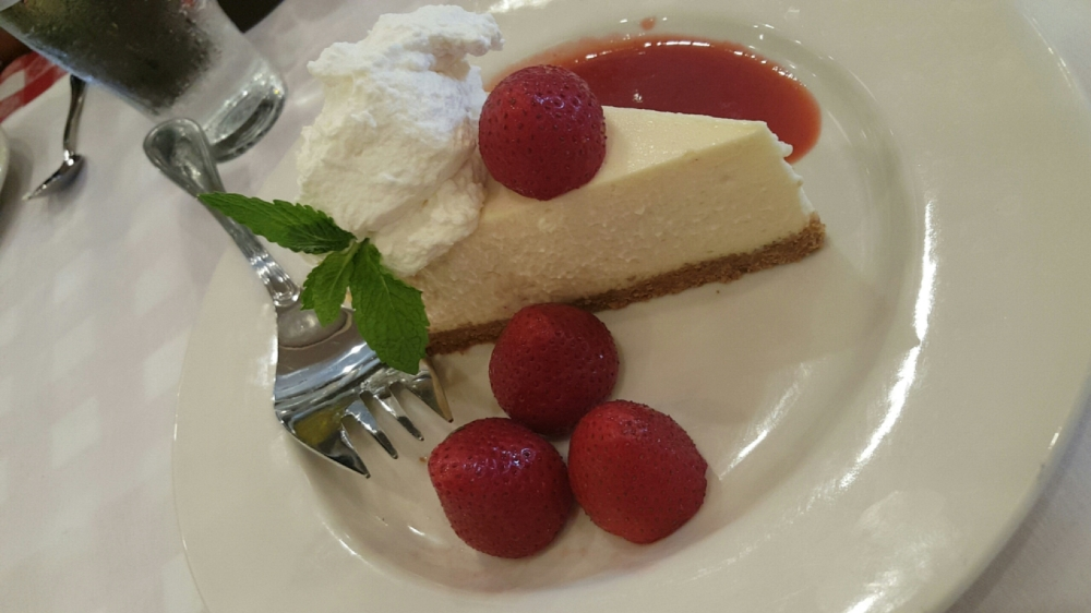 Cheesecake with strawberries and sauce - this is worth breaking any diet for!