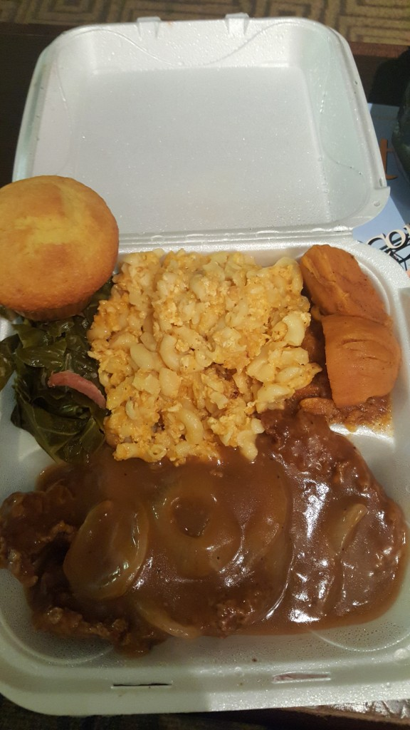 Smothered Pork Chops, Mac and Cheese, Yams, Greens and Cornbread