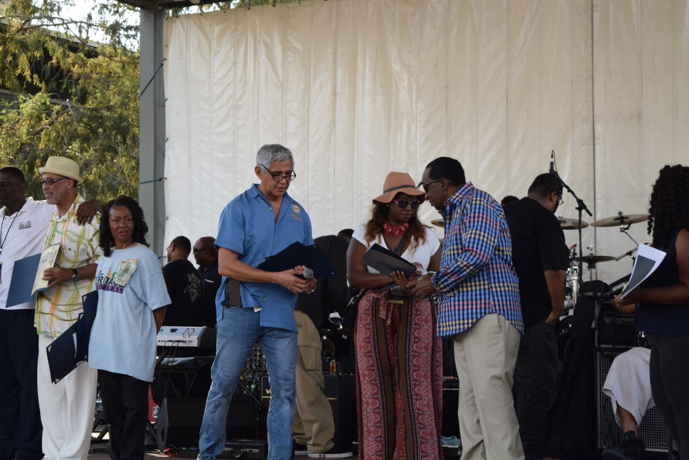 Houston City Council Member Robert Gallegos presents Wash Allen with a special recognition certificate.
