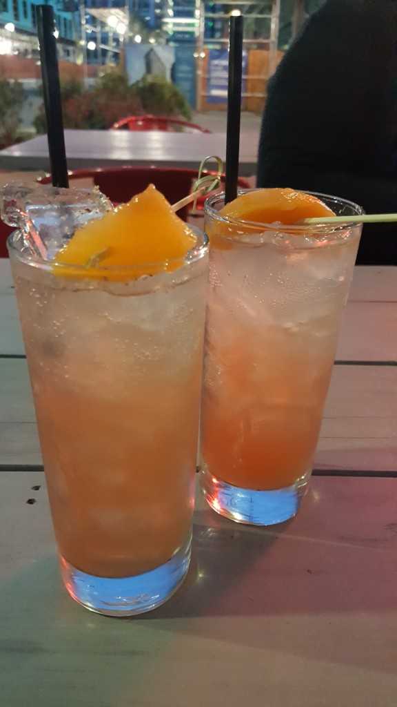 The Peach Daisy: House Peach Cobbler Bourbon, Combier, Lemon, Pomegranate & Soda