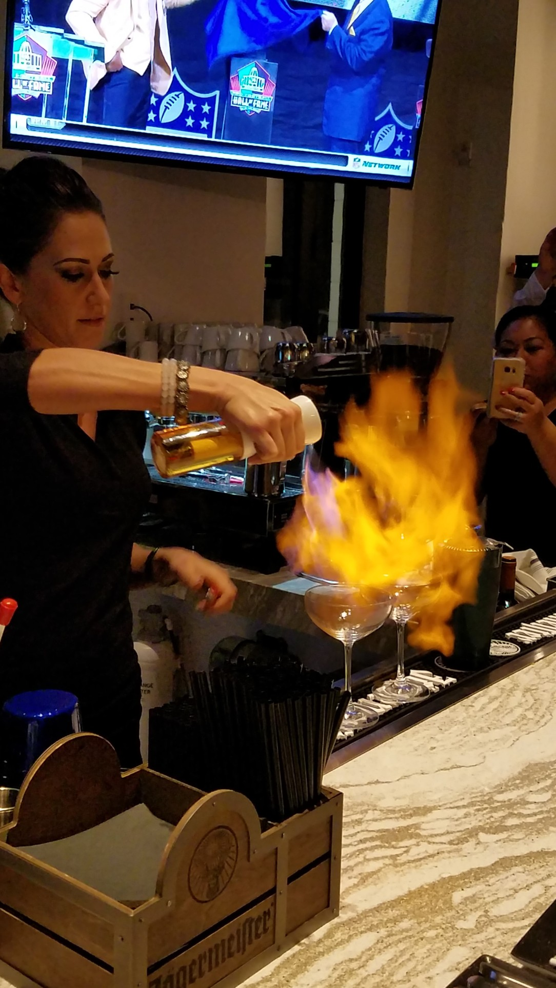 We're getting a first-hand demonstration of how to make the cocktail Dante's Inferno