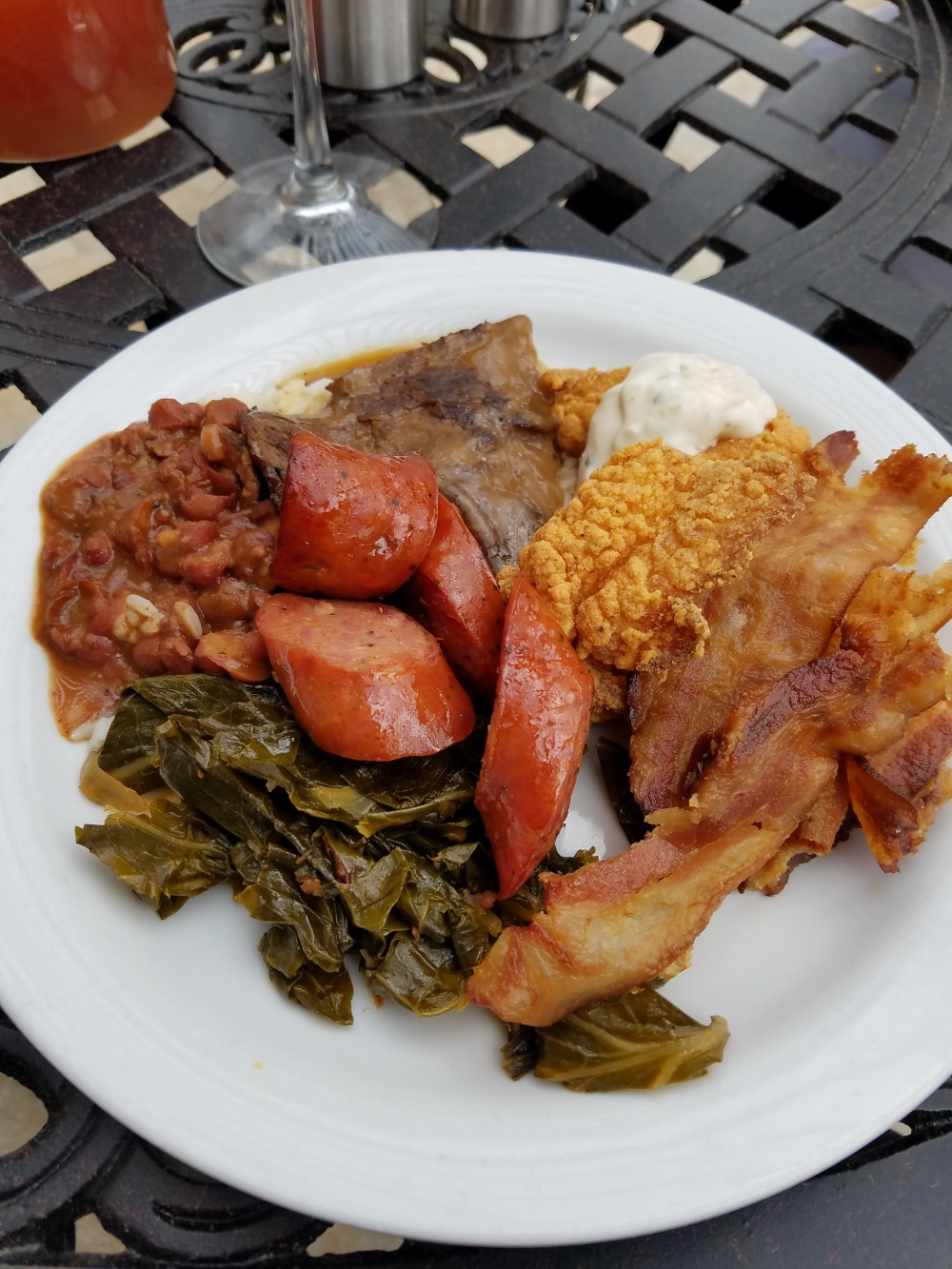 Just a sampling - greens, sausage, red beans & rice, smothered steak, catfish and slice of bacon